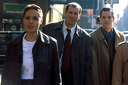 Nov 11, 1999; Hollywood, CA, USA; Actress ANGELINA JOLIE as Amelia Donaghy, ED O'NEILL as Paulie Sellitto and MIKE McGLONE as Kenny Solomon star in the new thriller 'The Bone Collector'..  (Credit Image: ZUMA Press/ZUMAPRESS.com) (Credit Image: © ZUMA Press/Entertainment Pictures/ZUMAPRESS.com)