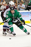 DALLAS, TX - SEPTEMBER 26:  Cody Eakin #20 of the Dallas Stars controls the puck against the Colorado Avalanche in an NHL preseason game on September 26, 2013 at the American Airlines Center in Dallas, Texas.  (Photo by Cooper Neill/Getty Images) *** Local Caption *** Cody Eakin