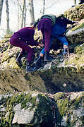 Taylor, Tackley and Edema climbing rocks, Switzerland, 1980s