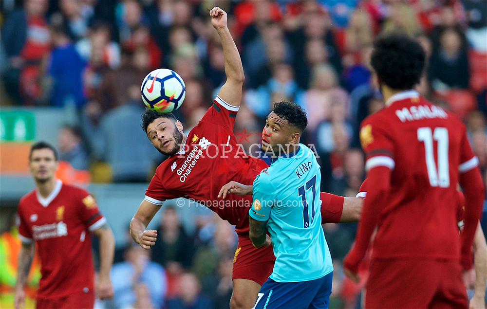 LIVERPOOL, ENGLAND - Saturday, April 14, 2018: Liverpool's Alex Oxlade-Chamberlain and AFC Bournemouth's Joshua King (right) during the FA Premier League match between Liverpool FC and AFC Bournemouth at Anfield. (Pic by Laura Malkin/Propaganda)