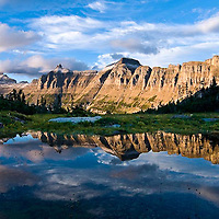 summer reflection of the garden wall in glacier national park, crown of the continent, montana, usa