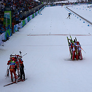 Winter Olympics, Vancouver, 2010.The Austrian team, right, of Bernhard Gruber, David Kreiner, Felix Gottwald and Mario Stecher celebrate their Gold Medal win during the Nordic Combined Team/4X5KM competition as the USA team of Brett Camerota, Todd Lodwick, Johnny Spillane and Bill Demong, left, celebrate their Silver Medal win at Whistler Olympic Park , Whistler, during the Vancouver Winter Olympics. 23nd February 2010. Photo Tim Clayton