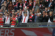 Arsenal manager Arsène Wenger lifts the FA Cup during the The FA Cup final match between Arsenal and Chelsea at Wembley Stadium, London, England on 27 May 2017. Photo by Shane Healey.