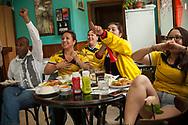 Colombian football fans watch their national team's Russia 2018 World Cup Group H match against Japan in a bar. Irun (Basque Country). June 19, 2018. (Gari Garaialde / BostokPhoto)