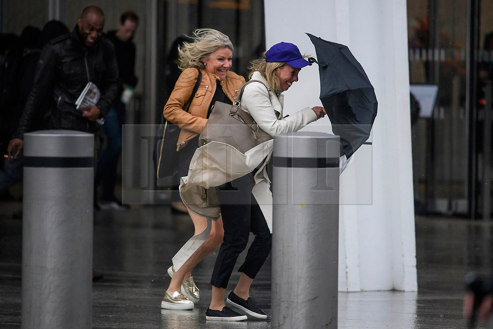 © Licensed to London News Pictures. 06/06/2017. London, UK.  Commuters fight with their umbrellas as the battle against gales and heavy rain while leaving London Bridge Station as the capital is hit by wintery conditions. Photo credit: Ben Cawthra/LNP