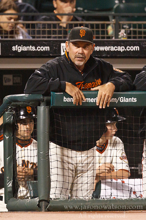 August 30, 2010; San Francisco, CA, USA;  San Francisco Giants manager Bruce Bochy (15) watches the game against the Colorado Rockies from the dugout during the fifth inning at AT&T Park.  Colorado defeated San Francisco 2-1.
