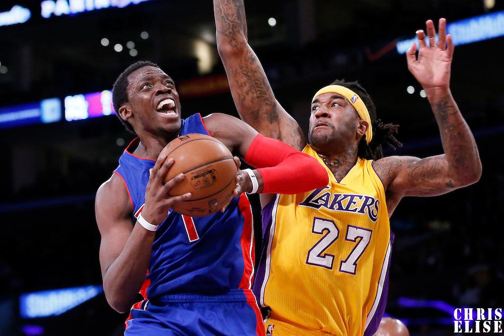 10 March 2015: Detroit Pistons guard Reggie Jackson (1) drives past Los Angeles Lakers center Jordan Hill (27) during the Los Angeles Lakers 93-85 victory over the Detroit Pistons, at the Staples Center, Los Angeles, California, USA.