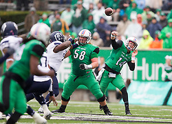 Oct 3, 2015; Huntington, WV, USA; Marshall Thundering Herd quarterback Chase Litton completes a pass over the middle during the first quarter against the Old Dominion Monarchs at Joan C. Edwards Stadium. Mandatory Credit: Ben Queen-USA TODAY Sports