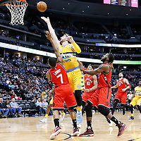 18 November 2016: Denver Nuggets center Jusuf Nurkic (23) goes for the layup past Toronto Raptors guard Kyle Lowry (7) during the Toronto Raptors 113-111 OT victory over the Denver Nuggets, at the Pepsi Center, Denver, Colorado, USA.