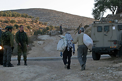 60620222<br /> Israeli soldiers guard as Palestinian farmers make their way to harvest olive trees in Salem village, near the Jewish settlement of Elone Moreh, east of the West Bank city of Nablus on Monday Oct. 21, 2013. Picture by imago /  i-Images<br /> UK ONLY