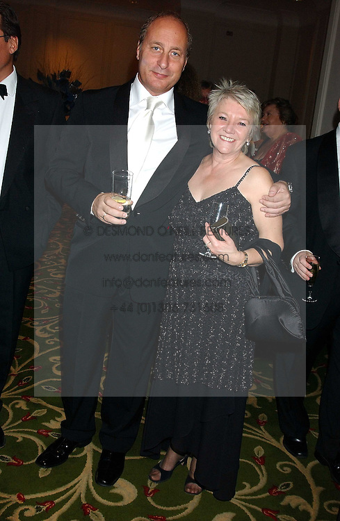 DIANNE THOMPSON, Chief Executive of Camelot PLC and ANDREW KITCHING at the children's charity ChildLine 19th Birthday Ball held at the Grosvenor House Hotel, Park Lane, London on 29th October 2005.<br />