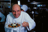 Bernard Loiseau with his signature froglegs with purees of garlic and parsley -  Restaurant C(TM)te d'Or, Saulieu, Burgundy, 1999.© Owen Franken