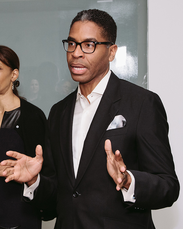 NEW YORK - March 27: Reggie Canal at FOKAL's The Promise of Haiti II Event. Photographed March 27, 2015 at the Medici Group in NY, NY. 2015 © Cat Laine.