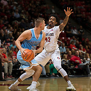 10 November 2017:  The San Diego State Aztecs men's basketball team opens up the season against San Diego Christian. San Diego State Aztecs guard Jeremy Hemsley (42) puts the full court press on San Diego Christian Hawks forward Nick Crankshaw (22) in the first half. The Aztecs lead the Hawks 46-24 at the half.<br /> www.sdsuaztecphotos.com