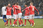 Walsall Forward,  Tom Bradshaw  is congratulated on his goal by his team mates during the Sky Bet League 1 match between Bury and Walsall at Gigg Lane, Bury, England on 16 January 2016. Photo by Mark Pollitt.