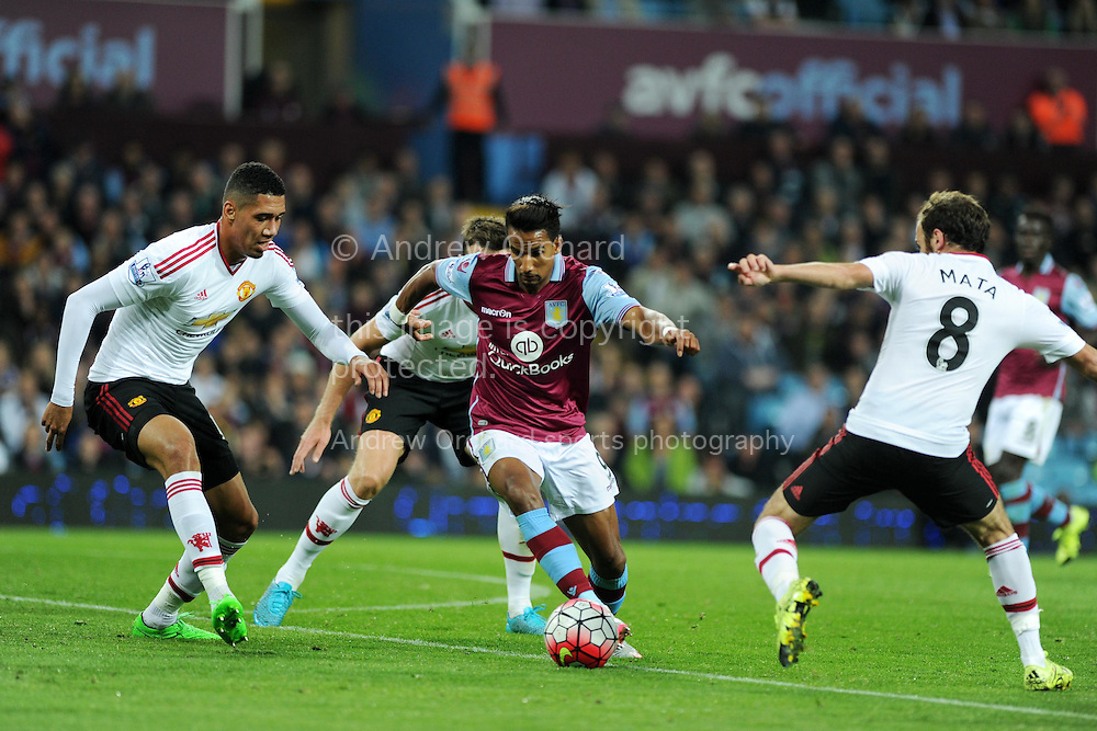 Scott Sinclair of Aston Villa (c) goes past Chris Smalling (l) and Juan Mata of Manchester Utd.  Barclays Premier League match, Aston Villa v Manchester Utd at Villa Park in Birmingham, Midlands on Friday 14th August  2015.<br /> pic by Andrew Orchard, Andrew Orchard sports photography.