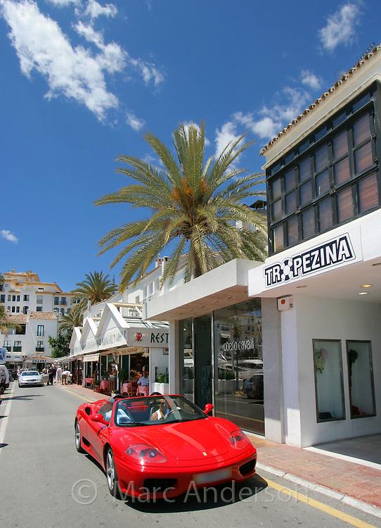 A red Ferrari in Puerto Banus, Marbella, Spain
