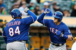 OAKLAND, CA - JUNE 14:  Ryan Rua #16 of the Texas Rangers is congratulated by Prince Fielder #84 after hitting a home run against the Oakland Athletics during the third inning at the Oakland Coliseum on June 14, 2016 in Oakland, California. (Photo by Jason O. Watson/Getty Images) *** Local Caption *** Ryan Rua; Prince Fielder