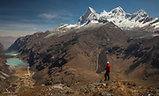Trekker above Yanganuco valley, four summits of Huandoy on right, Cordillera Blanca, Andes mountains, Peru