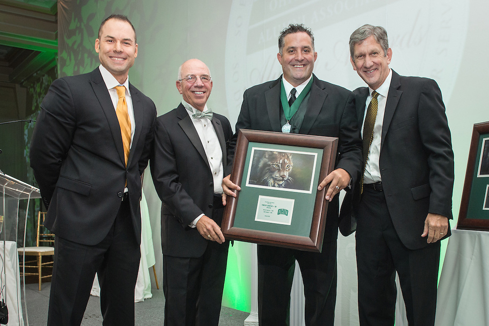 From left, Russ Eisenstein, Tom Davis, Timothy Courtad and Jim Schaus pose after Courtad was inducted into the Kermit Blosser Ohio Athletics Hall of Fame during the 2016 Alumni Awards Gala at Ohio University's Baker Center Ballroom on Friday, October 07, 2016.