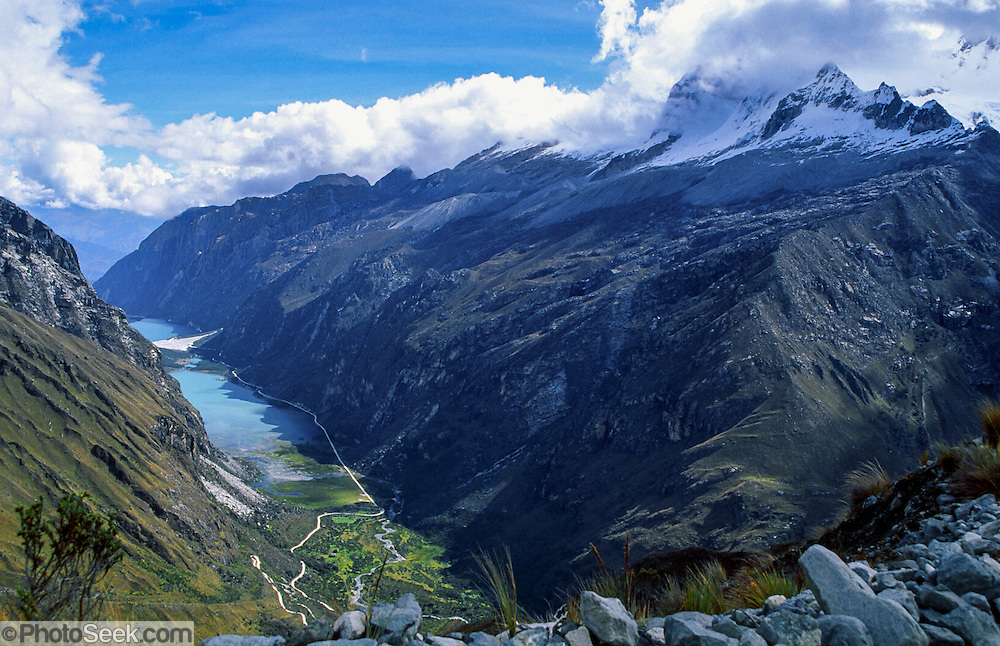 Huandoy, second highest mountain in the Cordillera Blanca, rises to 20,981 feet elevation, high above Llanganuco Valley and lakes at 12,000 feet above sea level, in the Andes Mountains, Peru, South America. UNESCO honored Huascaran National Park on the World Heritage List in 1985. The Cordillera Blanca mountain range is in the Sierra Central of the Peruvian Andes.
