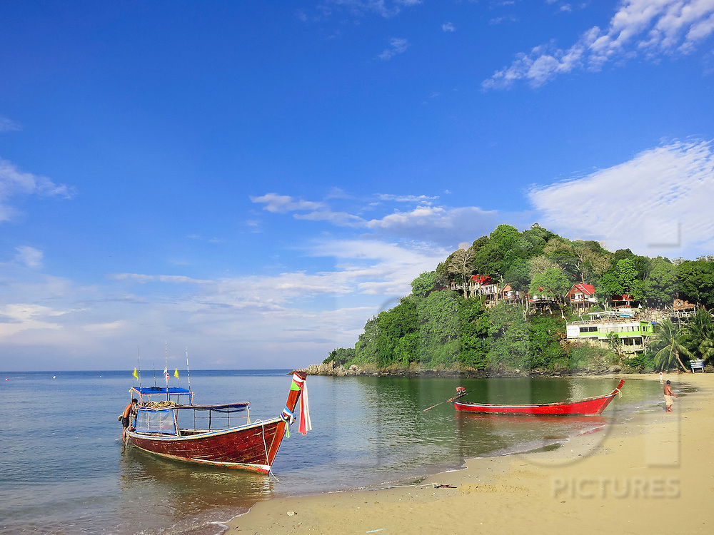 Long tail boats moored along Bakantiang Beach, Koh Lanta, Thailand, Southeast Asia
