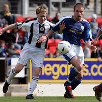 St Johnstone v St Mirren..07.05.05<br />Mark Reilly battles with Ryan Stevenson<br /><br />Picture by Graeme Hart.<br />Copyright Perthshire Picture Agency<br />Tel: 01738 623350  Mobile: 07990 594431