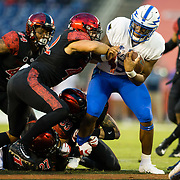 12 October 2018: San Diego State Aztecs linebacker Troy Cassidy (42) helps bring down Air Force Falcons quarterback Donald Hammond III (5) in the first quarter after a short gain. The San Diego State Aztecs lead 14-9 at the half against the Air Force Falcons at SDCCU Stadium Friday night.