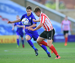 Lincoln City's Jack McMenemy vies for possession with Leicester City's Kyle Gruno<br /> <br /> Lincoln City under 18s Vs Leicester City under 18s at Sincil Bank, Lincoln.<br /> <br /> Picture: Chris Vaughan/Chris Vaughan Photography<br /> <br /> Date: July 28, 2016