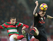 Maritimo´s player Alex Soares(L ) fights for the ball with Benfica's player Lindelof   (R ) during Portuguese First League football match C.S. Maritimo vs S.L. Benfica held at Barreiros Stadium, Funchal, Portugal, 01 December, 2016.