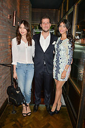 Left to right, GEMMA CHAN, GEORGE BUGAKOV  owner of Sackvilles and SANDRA KHOURY at a party to celebrate the launch of Sackville's Bar & Grill, 8a Sackville Street, London on 15th July 2015.