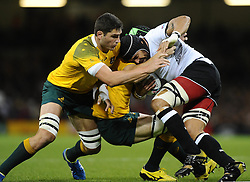 Fiji Number 8 Netani Talei is stopped by Australia Lock Rob Simmons and Australia Flanker Scott Fardy  - Mandatory byline: Joe Meredith/JMP - 07966386802 - 23/09/2015 - Rugby Union, World Cup - Millenium Stadium -Cardiff,Wales - Australia v Fiji - Rugby World Cup 2015 - Pool A