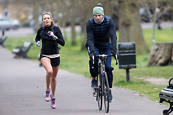 © Licensed to London News Pictures. 31/03/2020. London, UK. Members of the public exercise in Greenwich Park in South East London . The Government has announced a lockdown to slow the spread of Coronavirus and reduce pressure on the NHS. Photo credit: George Cracknell Wright/LNP