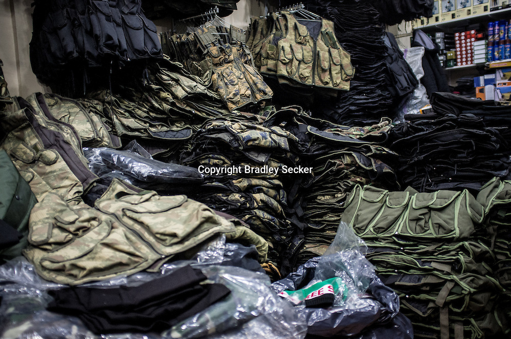 ANTAKYA, TURKEY. JANUARY 23. Military clothing and supplies are piled high at a supply store in Antakya, close to Turkey's border with Syria. Bradley Secker for the Washington Post