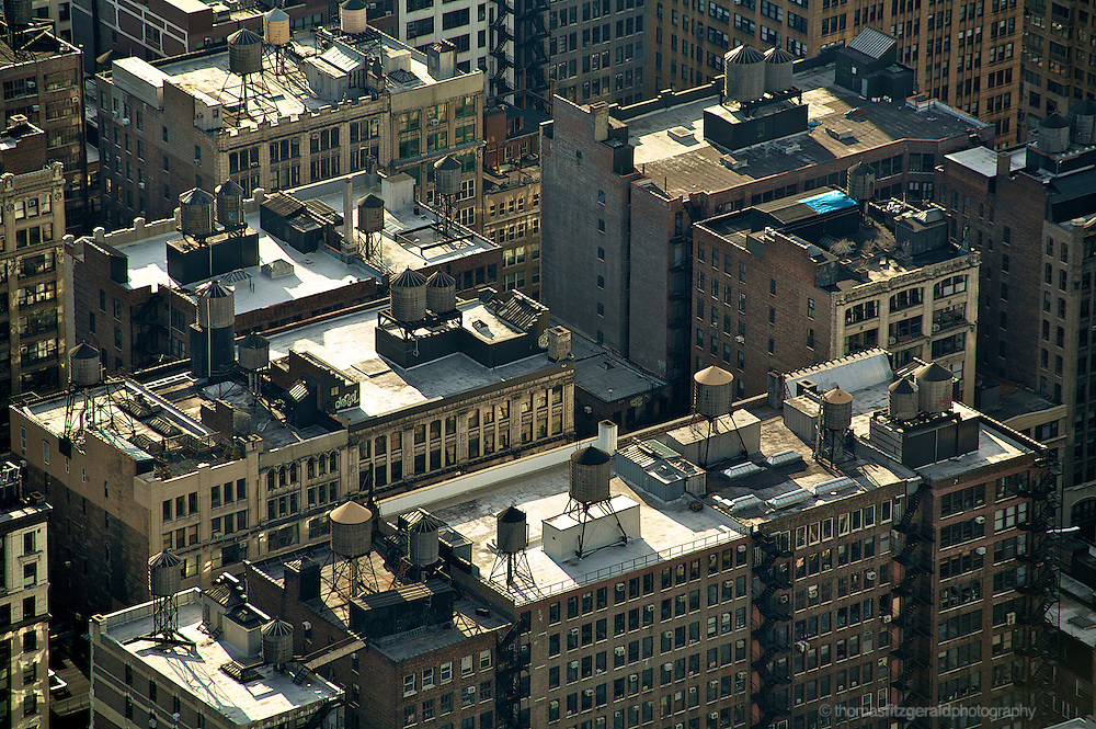 New York City rooftops showing the numerous water towers that adorn the top of these buildings