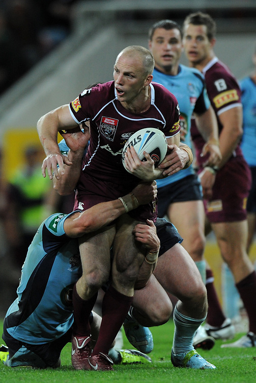 July 6th 2011: Maroons captain, Darren Lockyer is tackled during game 3 of the 2011 State of Origin series at Suncorp Stadium in Brisbane, QLD, Australia on July 6, 2011. Photo by Matt Roberts / mattrimages.com.au / QRL