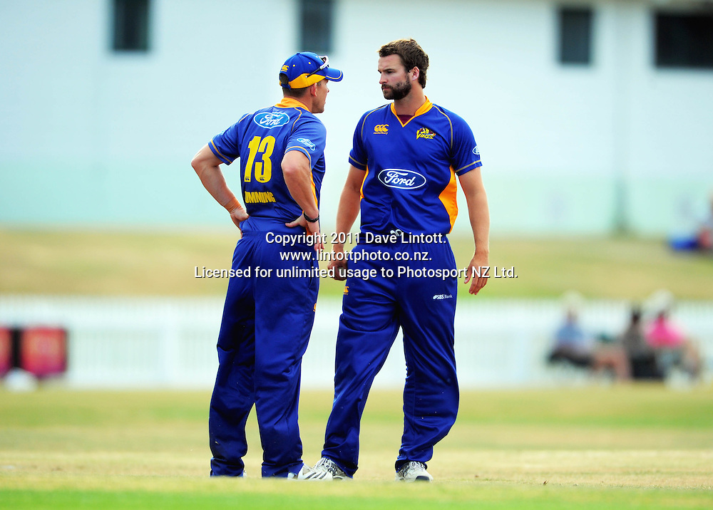 Otago captain Craig Cumming talks to bowler Craig Smith. One-day cricket - Central Stags v Otago Volts at Fitzherbert Park, Palmerston North, New Zealand on Sunday, 16 January 2011. Photo: Dave Lintott / photosport.co.nz