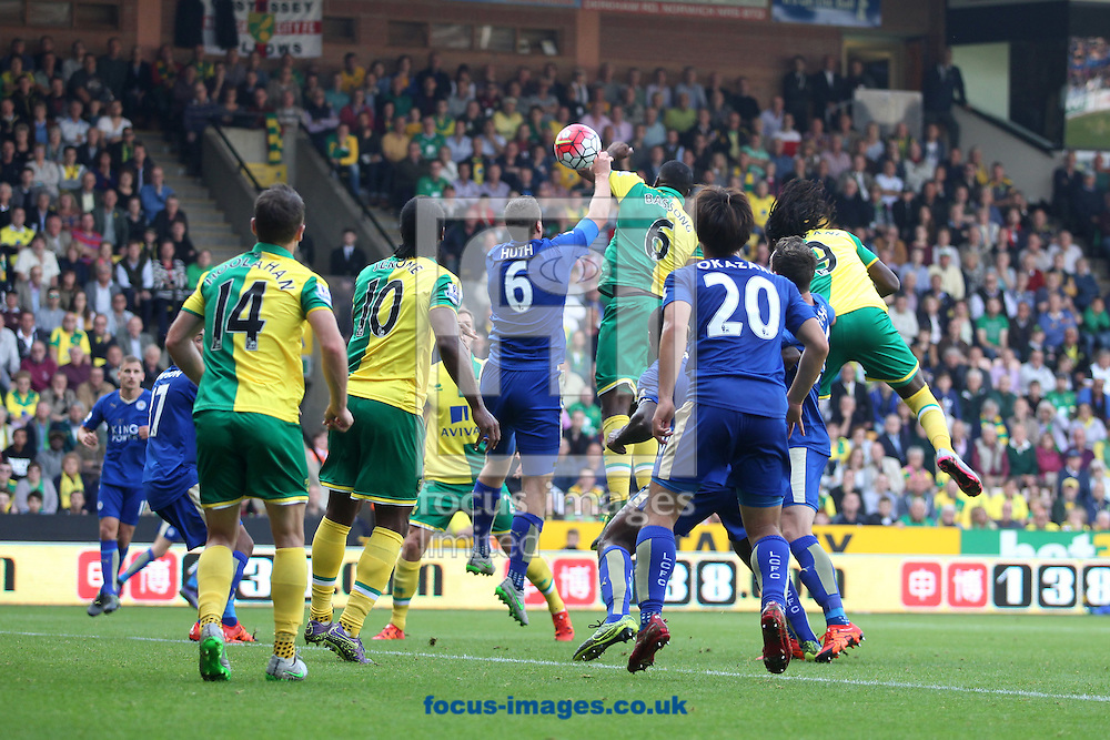 Robert Huth of Leicester City hand balls a header by Dieumerci Mbokani of Norwich but again no penalty is given by Referee Mark Clattenburg during the Barclays Premier League match at Carrow Road, Norwich<br /> Picture by Paul Chesterton/Focus Images Ltd +44 7904 640267<br /> 03/10/2015