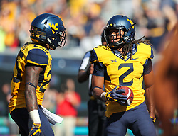 Oct 14, 2017; Morgantown, WV, USA; West Virginia Mountaineers wide receiver Ka'Raun White (2) celebrates after scoring a touchdown during the fourth quarter against the Texas Tech Red Raiders at Milan Puskar Stadium. Mandatory Credit: Ben Queen-USA TODAY Sports