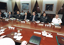 United States President George H.W. Bush meets with his military advisors in the Pentagon Gold Room at the Pentagon in Washington, D.C., the usual meeting place of the Joint Chiefs of Staff, on August 15, 1990 to discuss the U.S. military response to the Iraqi invasion of Kuwait. From left to right: White House Chief of Staff John Sununu; National Security Advisor Brent Scowcroft; General H. Norman Schwarzkopf, U.S. Army, Commander-in-Chief U.S. Central Command; U.S. Secretary of Defense Dick Cheney; President Bush; Chairman, Joint Chiefs of Staff Colin E. Powell; and Vice Chairman, Joint Chiefs of Staff, Admiral David E. Jeremiah, U.S. Navy.<br /> Mandatory Credit: Robert D. Ward / DoD via CNP /ABACAPRESS.COM
