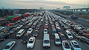 JIAXING, CHINA - JANUARY 03: (CHINA OUT) <br /> <br /> the traffic jam at a toll station on G60 Shanghai-Kunming Expressway at the end of New Years Day holiday on January 3, 2016 in Jiaxing, Zhejiang Province of China. People driving back after the 3-day holiday of the New Year\'s Day caused a 3-kilometer traffic jam at a toll station on G60 Shanghai-Kunming Expressway in Jiaxing. <br /> ©Exclusivepix Media