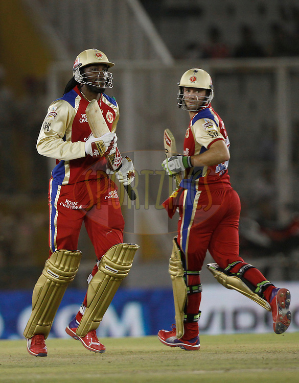 Royal Challengers Bangalore Chris Gayle and Royal Challengers Bangalore player AB De Villiers take a run during match 25 of the the Indian Premier League ( IPL) 2012  between The Kings X1 Punjab and The Royal Challengers Bangalore India held at the Punjab Cricket Association Stadium, Mohali on the 20th April 2012..Photo by Pankaj Nangiar/IPL/SPORTZPICS