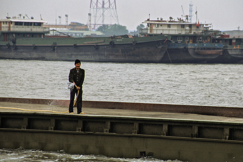 A man on a drudging ship purges his excess on the great Yangtze River.