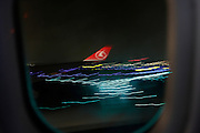 wing passenger airplane Turkish airline landing at night