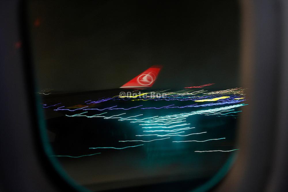 wing passenger airplane Turkish airline landing at night