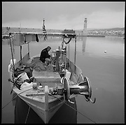 Fisher in his boat in the harbor of Rethymnon, western Crete. Autumn 2011. © Romano P. Riedo