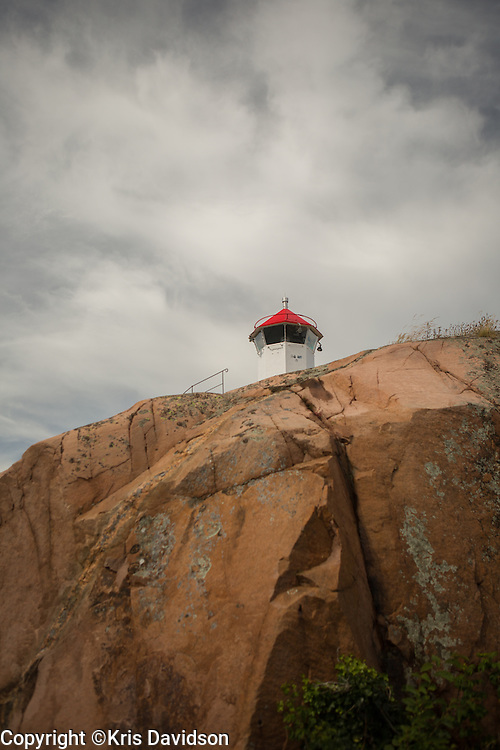 Small lighthouse on a cliff in the picturesque coastal town of Lysekil on Sweden's west coast.