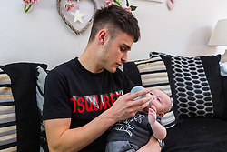 Dad Will Jones, 21 feeds young Jamie. Aimee Byron, 18, from Fareham in Hampshire  almost lost her baby Jamie after he was unable to keep food down due to a digestive complication that required delicate surgery. Jamie is now thriving. Fareham, Hampshire, May 01 2019.