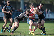 Scott Moore (Bradford Bulls) grabs Adam Clay (Oldham Roughyeds) during the Kingstone Press Championship match between Oldham Roughyeds and Bradford Bulls at Bower Fold, Oldham, United Kingdom on 2 April 2017. Photo by Mark P Doherty.