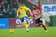 Accrington Stanley's Bradley Halliday and Exeter City's Joel Grant during the Sky Bet League 2 match between Exeter City and Accrington Stanley at St James' Park, Exeter, England on 23 January 2016. Photo by Graham Hunt.